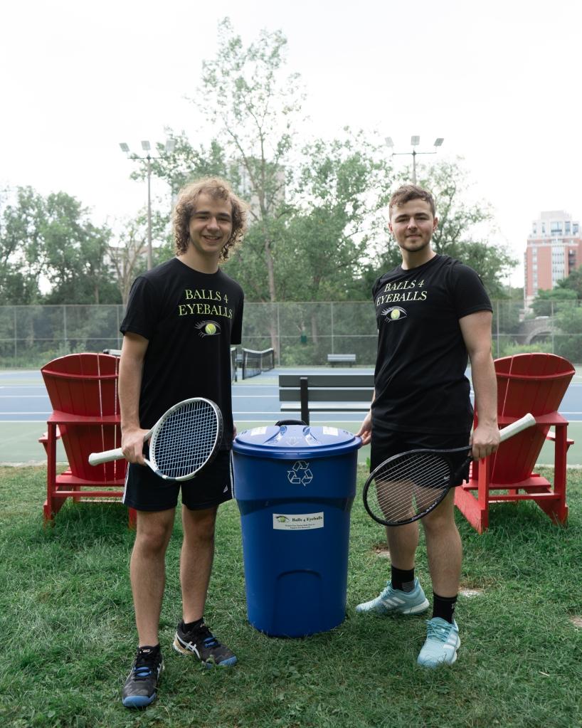 Photo of Ethan and Cooper Waisberg with a Balls 4 Eyeballs bin.
